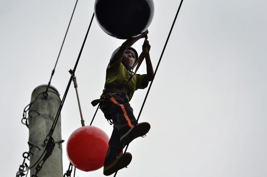 A Farrer Park Primary pupil taking part in adventure activities at the MOE Dairy Farm Outdoor Adventure Learning Centre. The new Sec 3 cohort camp, unlike the current two, will bring together students from various schools.