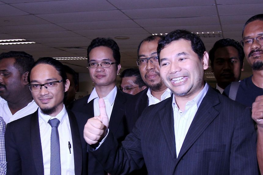 Mr Rafizi (right) was charged under the Official Secrets Act with unlawful possession of the Auditor-General's report on 1MDB and leaking a page of that document to the media on March 28.