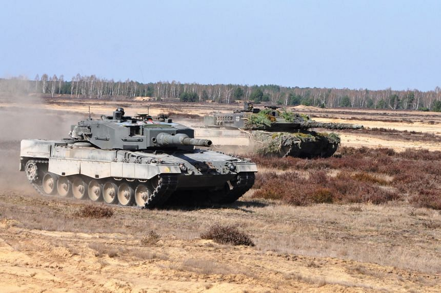 The Singapore Armed Forces' (SAF) Leopard 2SG main battle tank (foreground) and the German armed forces' Leopard 2A6 main battle tank participating in a live-firing drill in the Oberlausitz military training area in eastern Germany on Wednesday. More