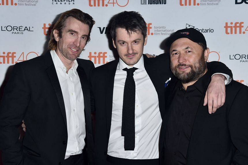 Russian- American first-person live-action shooter Hardcore Henry's (from far left) actor Sharlto Copley, director Ilya Naishuller and producer Timur Bekmambetov.