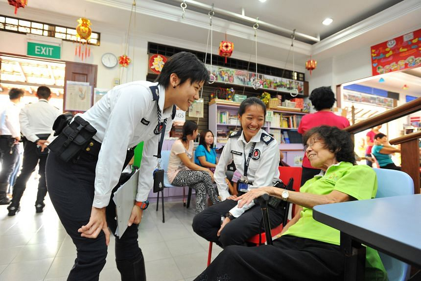 ASP Goh (left), 28, and Staff Sergeant Stephanie Cheung, 24, of TCOP - a new community policing unit - with Madam Ho Yin Heng, 76, at Xin Yuan Community Care centre at Block 205 Toa Payoh North. The unit had helped to establish a safer road crossing