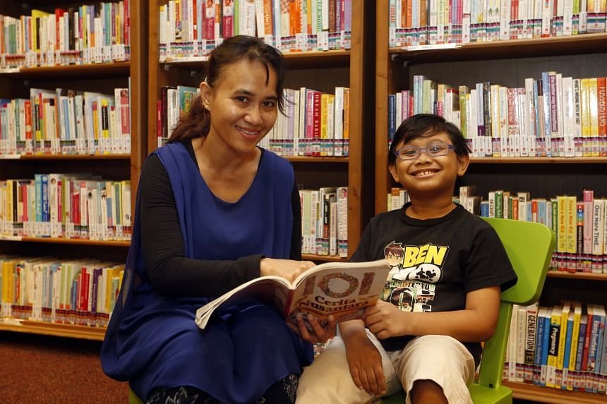 Madam Siti Sapura and her son Dhiya Durrani Ashraf Adri are members of Malay-language book club Kelab Membaca Wira Pintar at Tampines Regional Library. To encourage reading in Chinese, Malay and Tamil, the NLB will double the number of such mother to