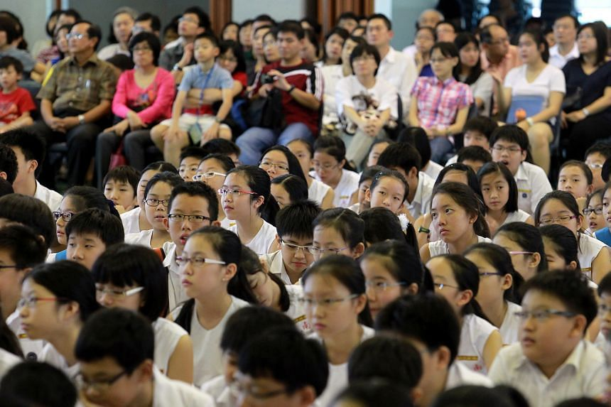 Pupils and parents waiting anxiously for PSLE results. Singapore's education system has gained a reputation for being highly competitive and overly focused on grades, but this is changing, very deliberately, at every level - from primary schools to t