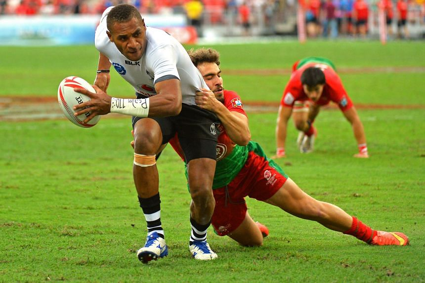 Fiji's Jasa Veremalua manages to shrug off the challenge of Portugal's Pedro Silverio to score a try in the pool match between Fiji and Portugal. The Fijians knocked 38 unanswered points past the Portuguese.