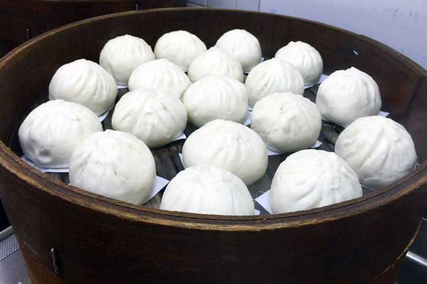 The big pau is filled with a quarter hard-boiled egg and slices of pork stir-fried with onions and bangkwang.