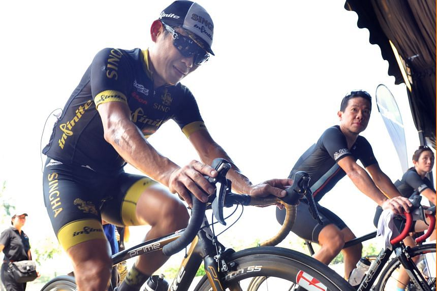 National cyclist Vincent Ang (left) putting a different spin on the sport yesterday as he joined over 300 cyclists at the F1 Pit Building to generate electricity in a 24-hour cyclothon which kicked off at noon. The cyclothon is part of the National G
