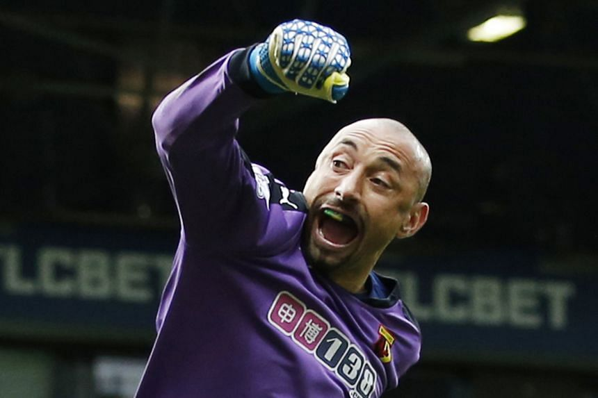 Watford 'keeper Heurelho Gomes celebrating their goal. His day got even better after he saved two penalties later.