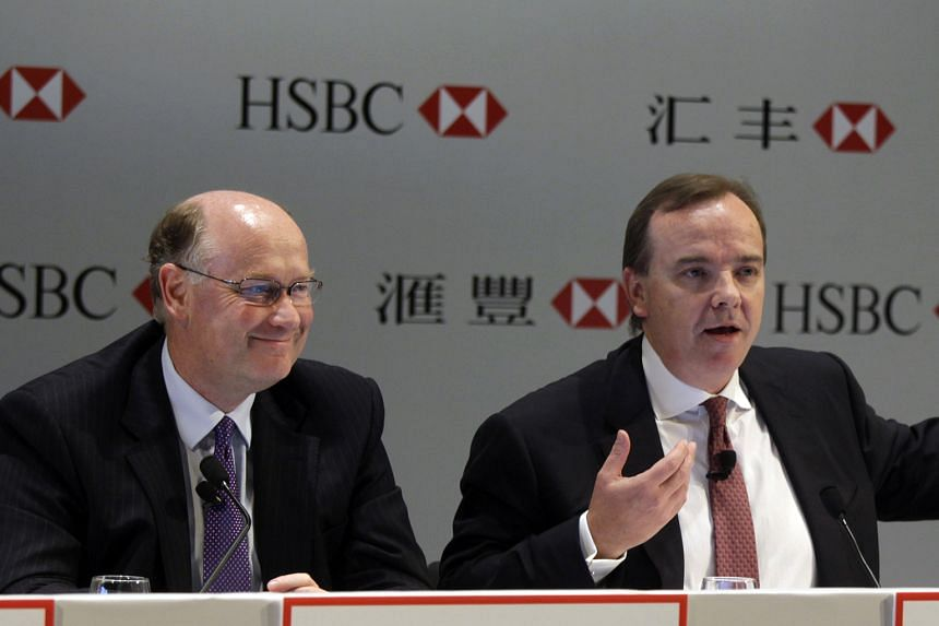 Mr Flint (far left), HSBC Holdings chairman, and Mr Gulliver, the bank's CEO, have announced 87,000 job cuts, exited over 80 businesses and cut the bank's global presence to 71 countries and territories since 2011. The bank has not commented on the S