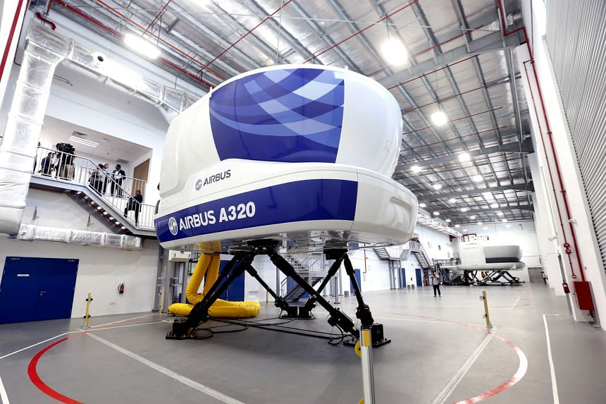A flight simulator at the Airbus Asia Training Centre which has 15 instructors, mainly former SIA pilots, and there are plans to hire up to 50 by 2019. To date, 17 airlines have signed up for courses at the facility.