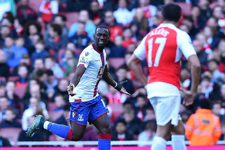 Crystal Palace's Yannick Bolasie celebrates after scoring against Arsenal during their league match at the Emirates. Arsene Wenger has admitted that the EPL title is beyond his reach after the 1-1 draw.