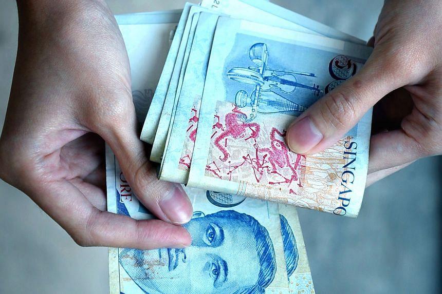 Analysts say the central bank's move to halt the Singdollar's rise will weigh on its performance in the coming months.