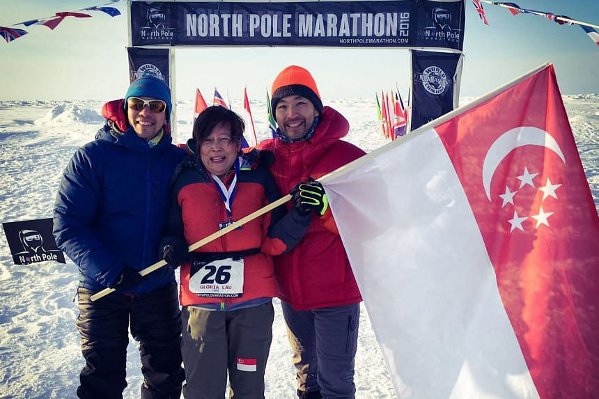 (From left) Mr Ong Yu-Phing, Ms Gloria Lau and Mr Ong Tze Boon at the finish line of the North Pole Marathon on Sunday. The start of the race had been delayed for about a week after cracks formed on the ice sheet in the Arctic Ocean.