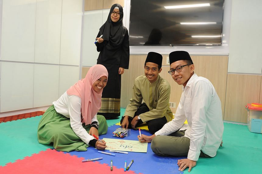 (From left) Ms Nur Zhafeerah Kamal and Ms Filzah Hanani Rahmad with youth development officer Muhammad Shahrum Sahid and youth exco member Wan Luqman Al-Hakim Dzulkarnain in the Al-Falah Mosque's new youth room.