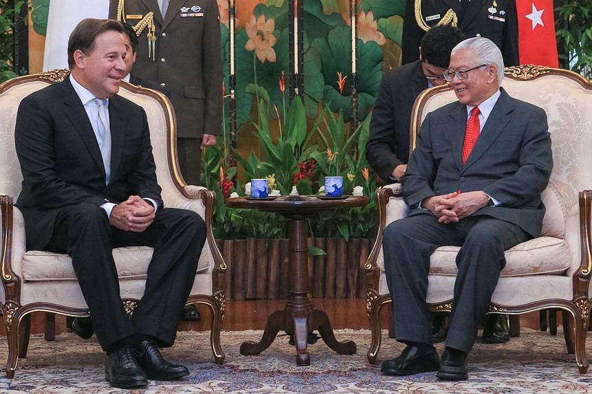 President Tony Tan Keng Yam with Panama President Juan Carlos Varela Rodríguez (left) yesterday. Dr Tan also hosted a state banquet at the Istana in Mr Varela's honour last night. Mr Varela, who was on a two-day state visit, was welcomed at an offic