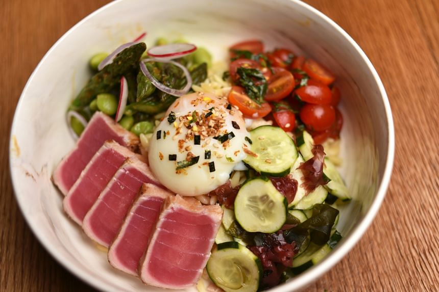 Tsukiji ($16), with tuna tataki, asparagus and edamame tossed in lemon juice and sesame oil, topped with an onsen egg
