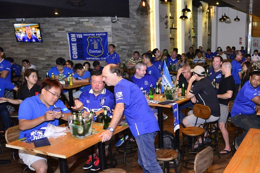 Everton fans at the Chang Beer-The Straits Times pre-screening party on Saturday, ahead of the FA Cup semi-final clash between the Toffees and Manchester United.