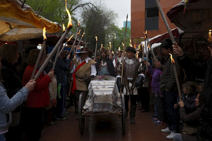 Actors take part in a mock funeral procession to commemorate the 400th anniversary of the death of Miguel de Cervantes, author of Don Quixote, in Alcala de Henares, outside Madrid.