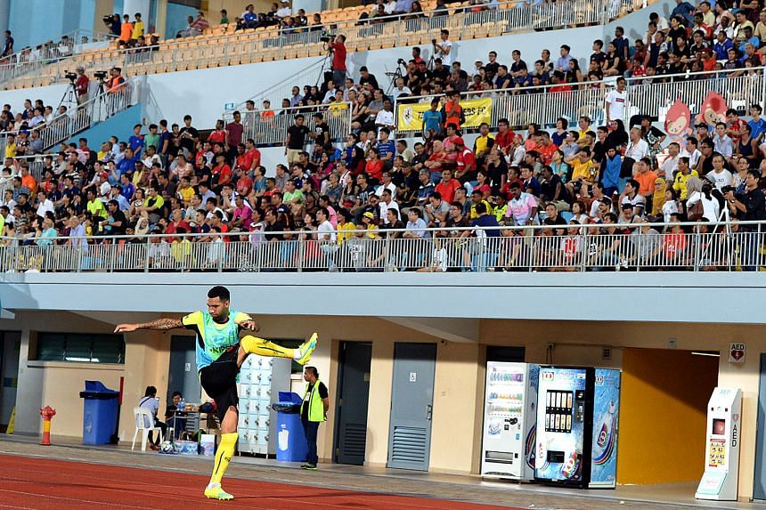 A section of the estimated 2,900 fans at the 3-3 draw between Tampines Rovers and Geylang International at Jurong West Stadium on Feb 15 watch as star attraction Jermaine Pennant warms up.