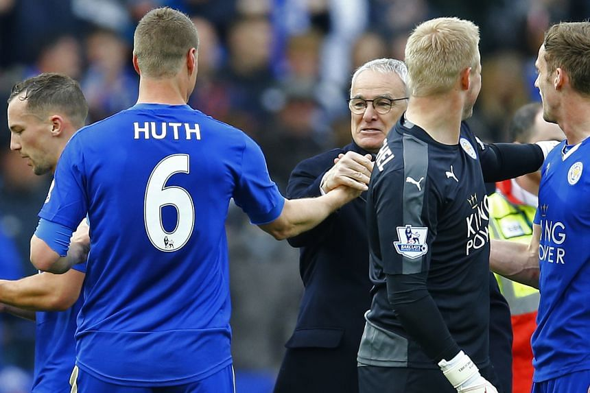Leicester City manager Claudio Ranieri congratulates his German centre-back Robert Huth after his side's resounding 4-0 victory over Swansea. The Foxes need five points from their remaining three games to fight off second-placed Tottenham's challenge