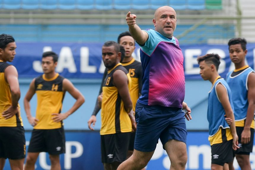 Balestier coach Marko Kraljevic instructs his players during training. The Tigers are hoping for a win to kickstart their season.