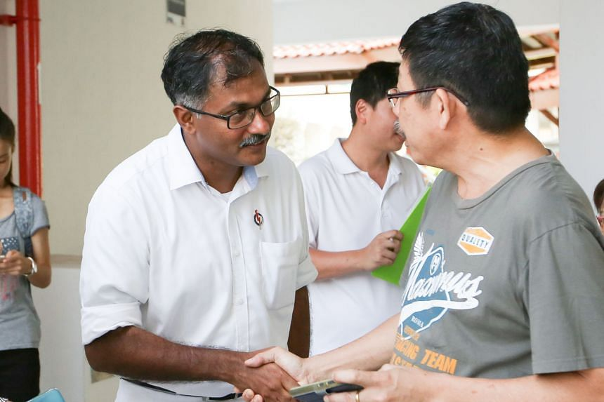 "Mr Murali Pillai visiting residents at Block 114, Bukit Batok West Avenue 6, during his walkabout. He has pledged to put his constituents first, saying his late father had taught him to ""always put community before self""."