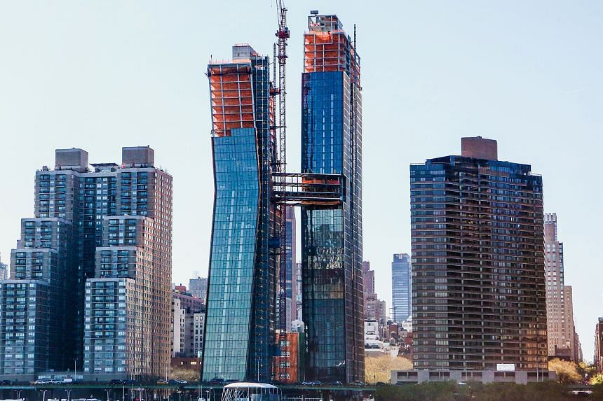 The American Copper Buildings (above) with the skybridge were designed by SHoP Architects.