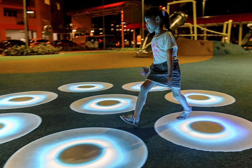 There are 16 light pads in a radial pattern (above) in two areas of the playground. They light up and change colours when they are stepped on.