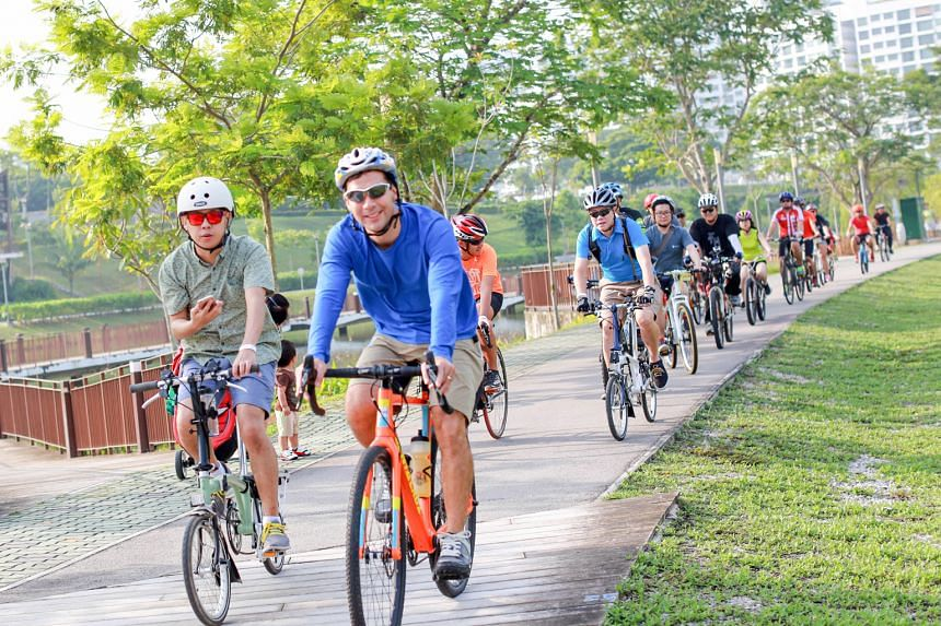 Participants of the OCBC Cafe Bike Crawl cycling along a 18km route at Punggol with numerous stops to eat and rest along the way. The bike crawl is one of the fringe activities ahead of the OCBC cycle in October.