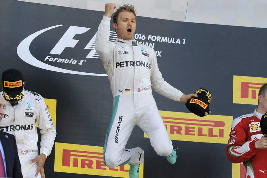 Mercedes driver Nico Rosberg jumps for joy on the podium as he celebrates his Russian Grand Prix victory. The German is the fourth driver in Formula One history to win seven consecutive races.