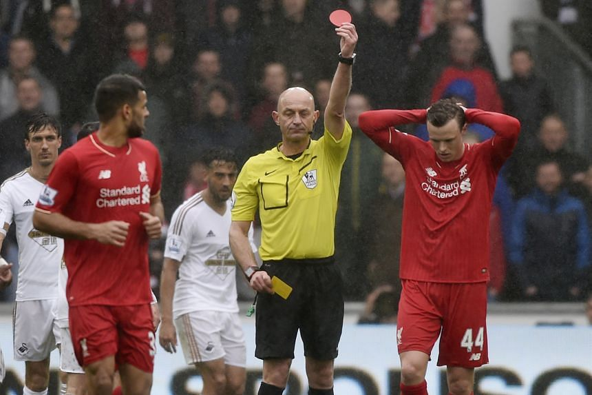 Liverpool defender Brad Smith (right) holds his head in his hands as referee Roger East shows him a second yellow card in the 76th minute. Smith was among eight changes Reds boss Juergen Klopp made to the side that lost to Villarreal in the Europa Le