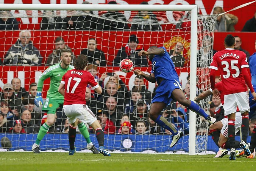 Leicester City's captain Wes Morgan (in blue) heading past Manchester United goalkeeper David de Gea for the equaliser. The match ended 1-1, which means the Foxes have only lost three of their 36 league games this season.