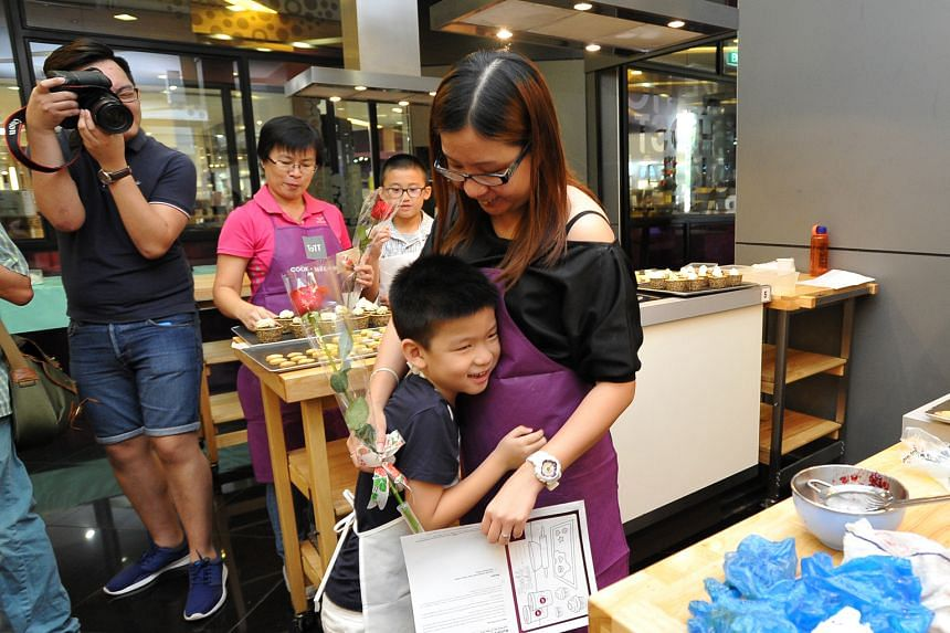 Ong Yehing giving his mother, Ms Lim Ting, a hug yesterday during a Mother's Day event organised by the Haemophilia Society of Singapore. Yehing is one of some 250 people in Singapore who suffer from haemophilia.