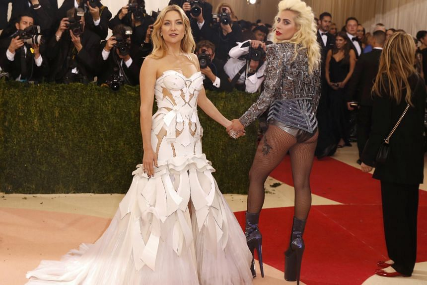 "Kate Hudson (far left) and Lady Gaga are two of the night's most superbly dressed celebrities. Gaga honours 1980s ""hair metal"" with her teased hair and beaded bolero jacket, while Hudson's fantastic plastic gown pays tribute to sci-fi."