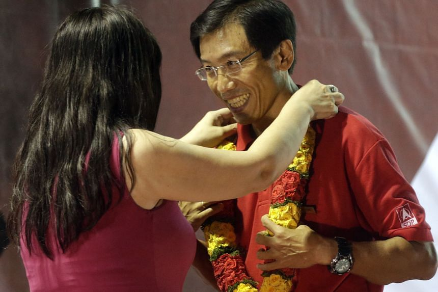 Dr Chee being presented with a garland after SDP's rally at a field in Bukit Batok yesterday. In his speech, the SDP chief said that if he was elected, he would also raise the plight of the elderly and CPF savings.