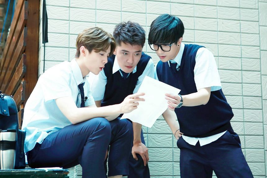 (Above from left) Singer Lu Han, actor Feng Shaofeng and singer Xue Zhiqian filming reality show Back To School.