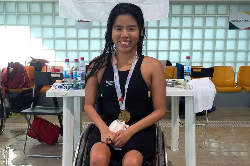 Yip Pin Xiu with her gold medal after winning the 50m back (S2) race at the IPC Swimming European Open Championships. With two backstroke world records, Yip is favourite to win gold at the Rio de Janeiro Paralympics.