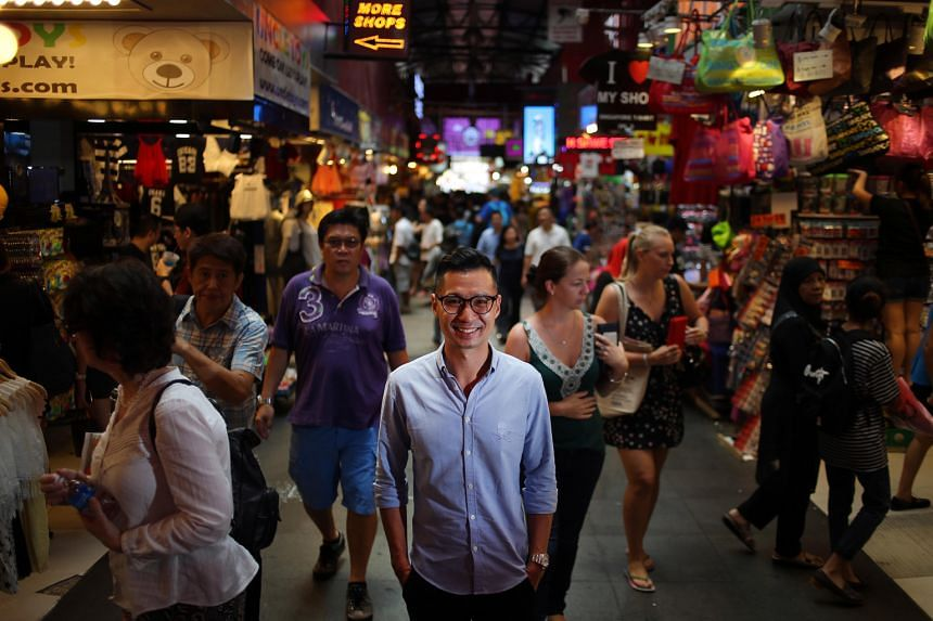 Bugis Street Online chief executive Ivan Loh (centre) believes retail today is about how the brick and mortar shops and e-commerce can complement each other.