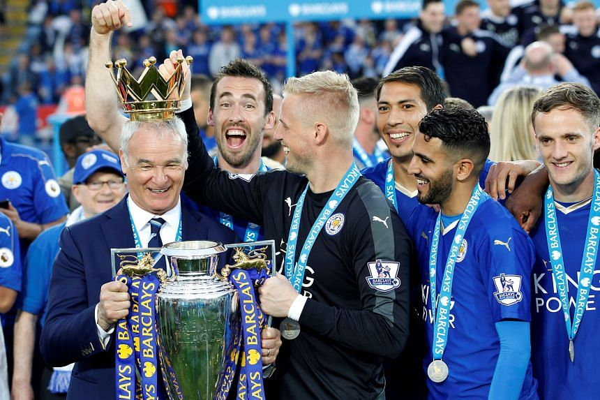 Leicester City manager Claudio Ranieri (from left), Christian Fuchs, Kasper Schmeichel, Leonardo Ulloa and Riyad Mahrez celebrating their Premier League win at the trophy presentation in front of their home fans.