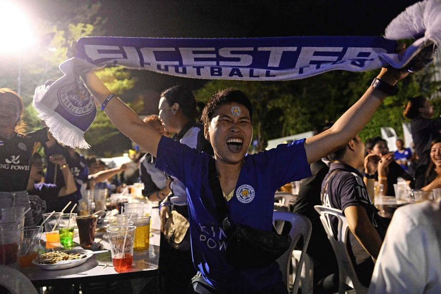 Foxes supporters cheering during the viewing party at Bangkok's King Power Complex, part of the duty-free chain owned by the Srivaddhanaprabha family.