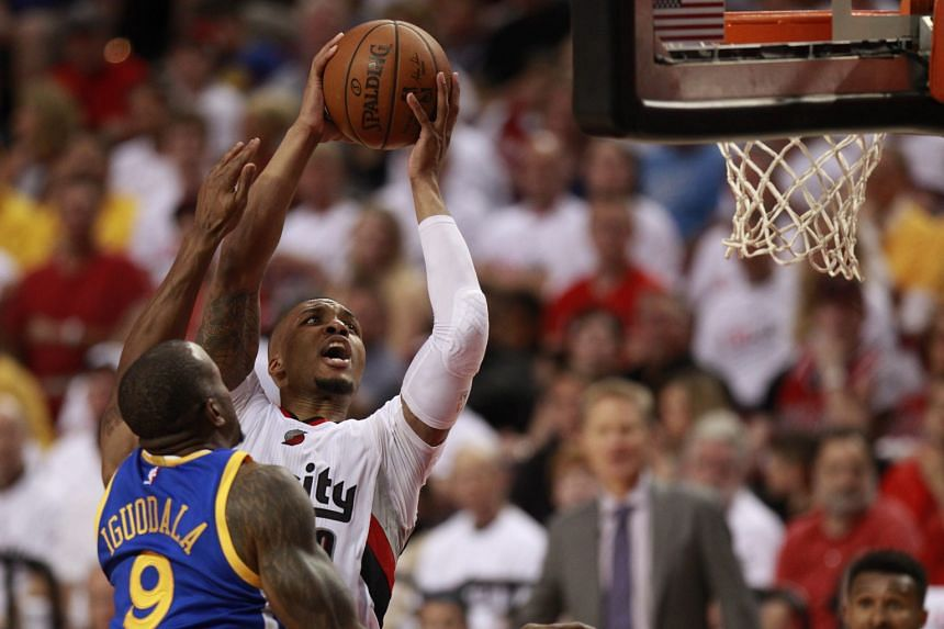 Portland Trail Blazers guard Damian Lillard taking a close-range shot against Golden State Warriors forward Andre Iguodala at the Moda Centre. But it was from beyond the arc that Lillard did the most damage, with his eight threes making up 24 of his
