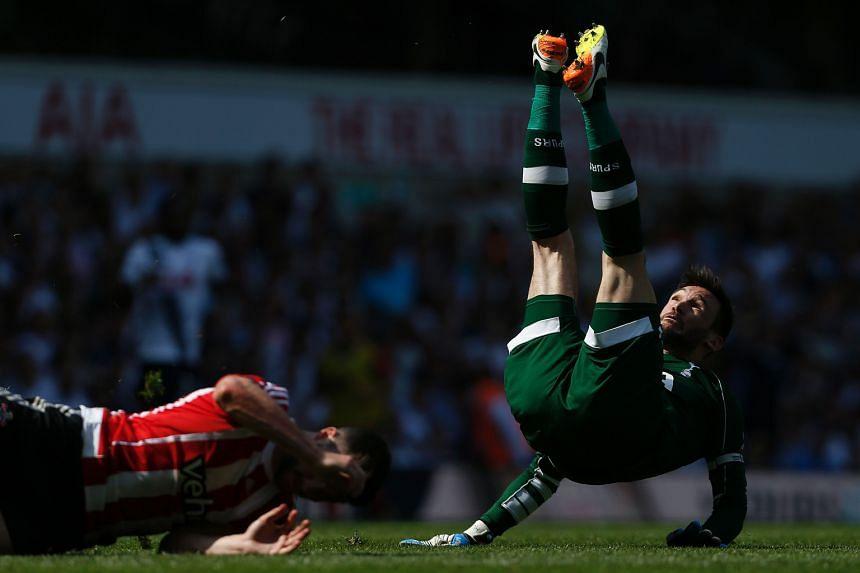 Tottenham goalkeeper Hugo Lloris landing heavily after being fouled by Southampton striker Shane Long.