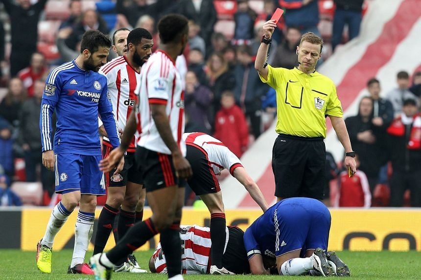 Referee Mike Jones dismisses Chelsea's John Terry after his challenge on Sunderland's Wahbi Khazri. The Blues skipper will miss the last two games of the season, and possibly his Chelsea career.