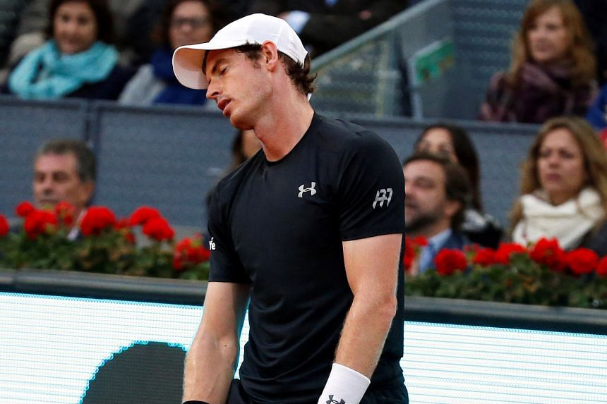 Although Andy Murray (right) lost Sunday's Madrid Open final to Novak Djokovic, he made his biggest progress under coach Amelie Mauresmo (above) on the claycourts.