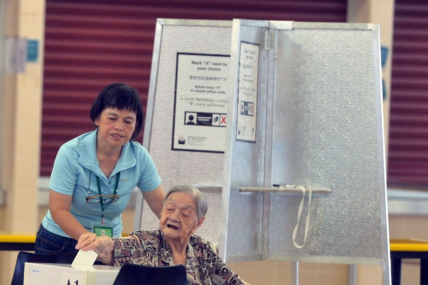 An elderly Bukit Batok voter casting her vote at the Bukit Batok Secondary School polling station on May 7.