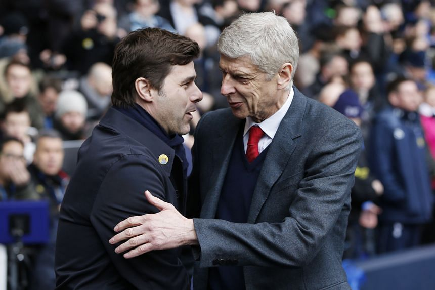 Arsenal manager Arsene Wenger (right) and Tottenham manager Mauricio Pochettino before their teams met on March 5