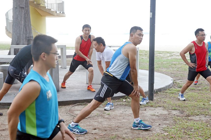 Minister for Social and Family Development Tan Chuan-Jin stretching during a run with grassroots volunteers at East Coast Park. Mr Tan will be participating in The Straits Times Run in the City next Sunday.