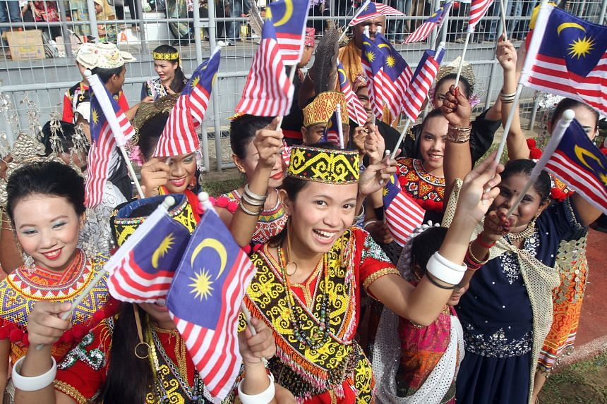 "Malaysia Day celebrations in Kuching, Sarawak. Kali, author of The Malaysia That Could Be, loves to describe ordinary Malaysians living modestly and uncomplainingly in rural splendour - ""the rich cultural diversity, the beauty of the different cultur"