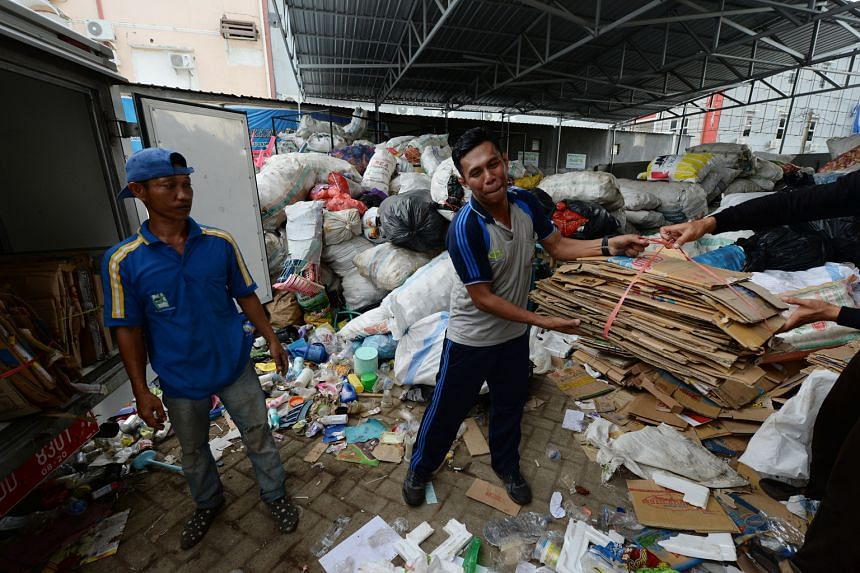 A bundle of cardboard being taken to the Mutiara Trash Bank in Makassar on Sulawesi island on March 11. Residents take recyclable trash to collection points, where it is weighed and given a monetary value.