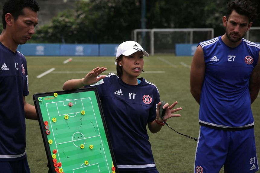 Hong Kong trailblazer Chan Yuen Ting, during training with assistant coach Lai Kai Cheuk and Australian forward Andrew Barisic, is the first female coach to take a men's football team to a top-flight title.