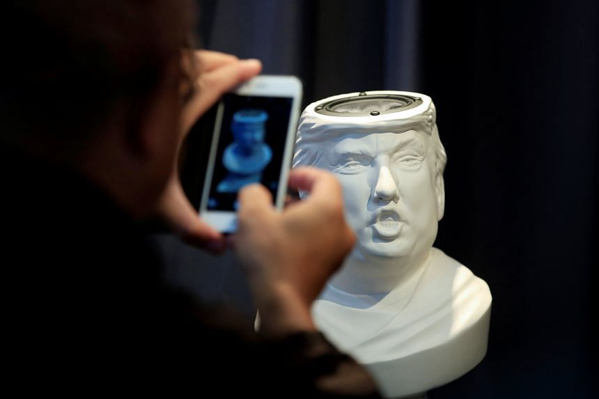 A man taking a picture of a Sound Of Power speaker in the shape of a bust of Mr Trump. Ms Brewer Lane is disputing the New York Times' account of her meeting with the presumptive Republican presidential nominee in 1990.